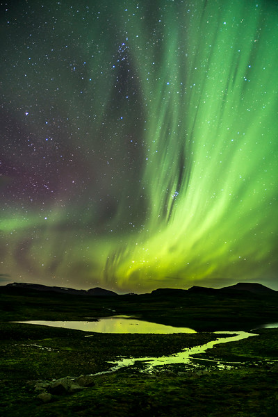 Aurora Borealis over Mountain Lake