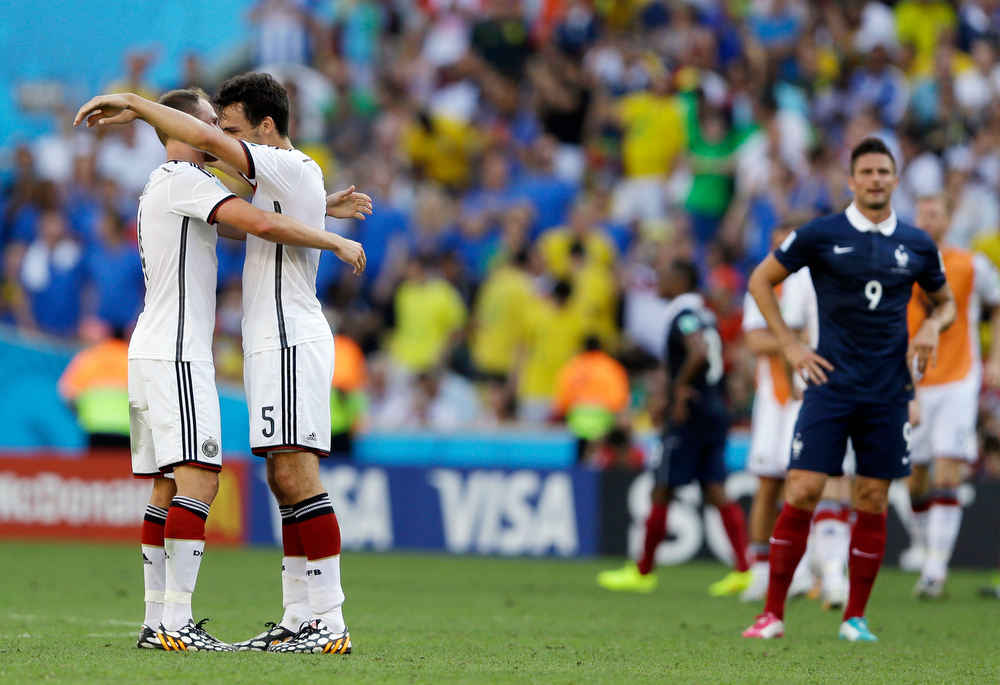 . Germany\'s Benedikt Hoewedes, left, and Mats Hummels celebrate after defeating France 1-0 to advance to the semifinals during the World Cup quarterfinal soccer match between Germany and France at the Maracana Stadium in Rio de Janeiro, Brazil, Friday, July 4, 2014. (AP Photo/Kirsty Wigglesworth)