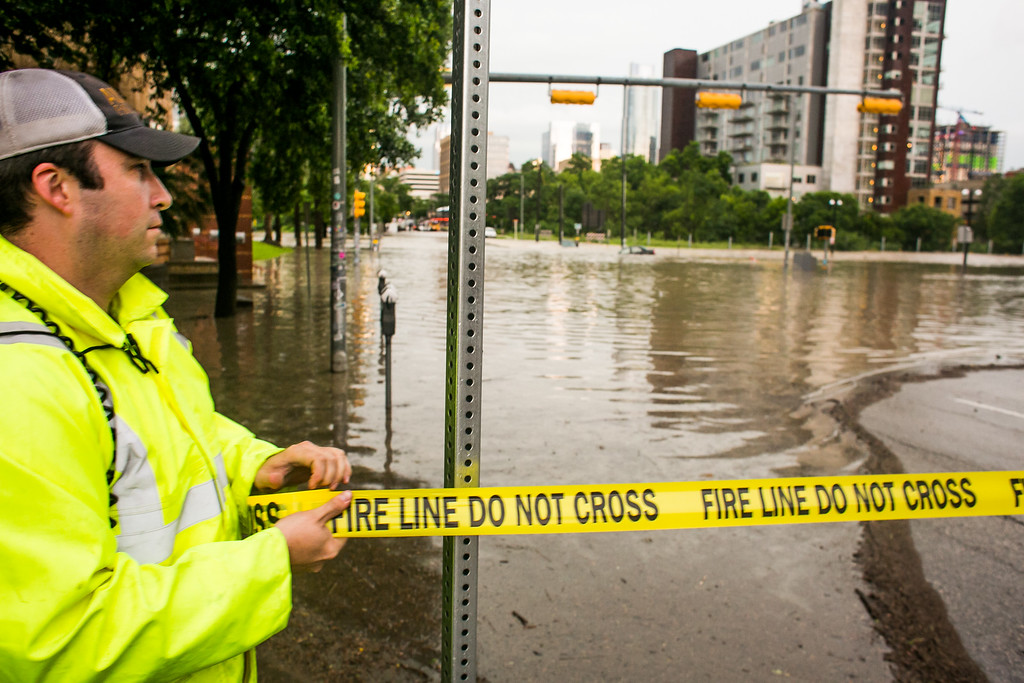 . AUSTIN, TX - MAY 25:   Tape is stretched across a flooded Sixth Street after days of heavy rain on May 25, 2015 in Austin, Texas. Texas Gov. Greg Abbott toured the damage zone where one person is confirmed dead and at least 12 others missing in flooding along the Rio Blanco, which reports say rose as much as 40 feet in places, caused by more than 10 inches of rain over a four-day period. The governor earlier declared a state of emergency in 24 Texas counties.  (Photo by Drew Anthony Smith/Getty Images)