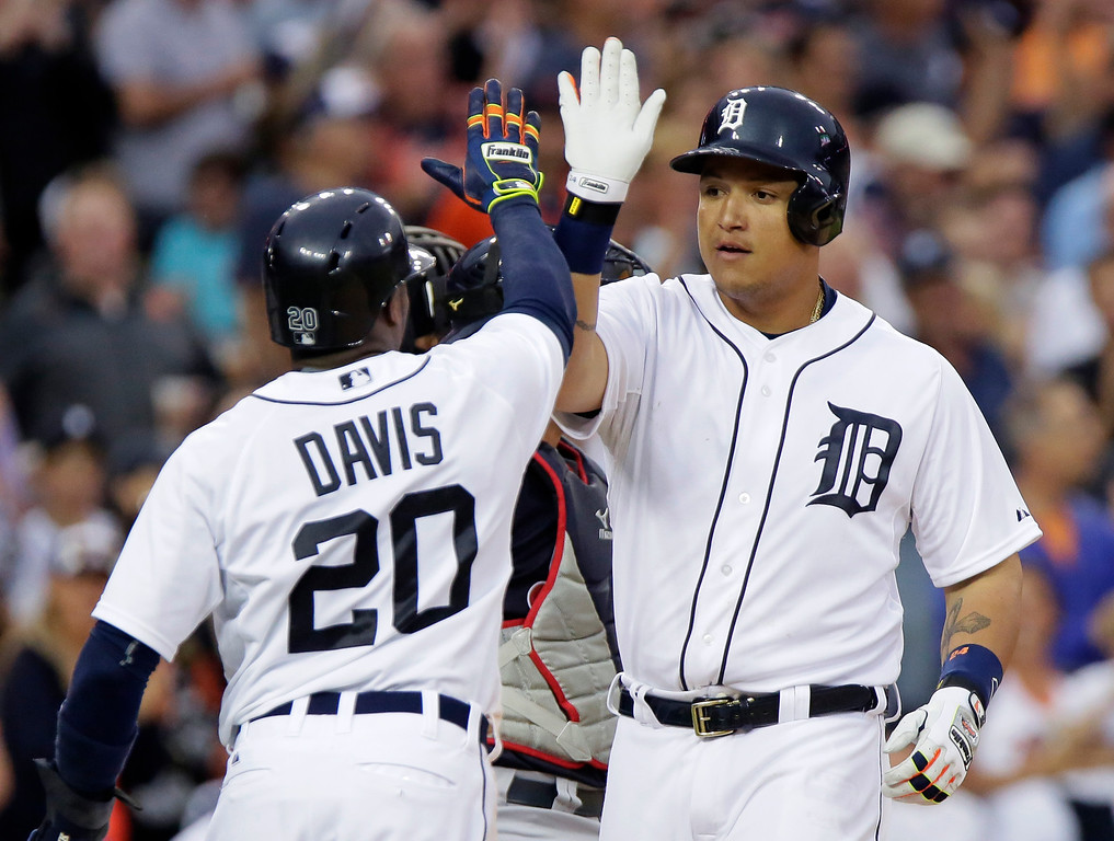 . Detroit Tigers\' Miguel Cabrera receives a high-five from Rajai Davis (20) after hitting a three-run home run against the Cleveland Indians during the sixth inning of a baseball game Friday, June 12, 2015, in Detroit. (AP Photo/Duane Burleson)