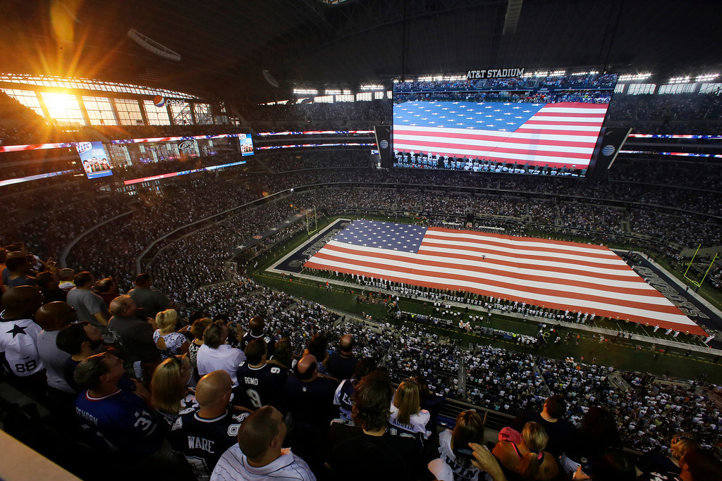 . The U.S. national anthem is played at AT&T Stadium before an NFL football game between the Dallas Cowboys and the New York Giants, Sunday, Sept. 8, 2013, in Arlington, Texas. (AP Photo/Tony Gutierrez)