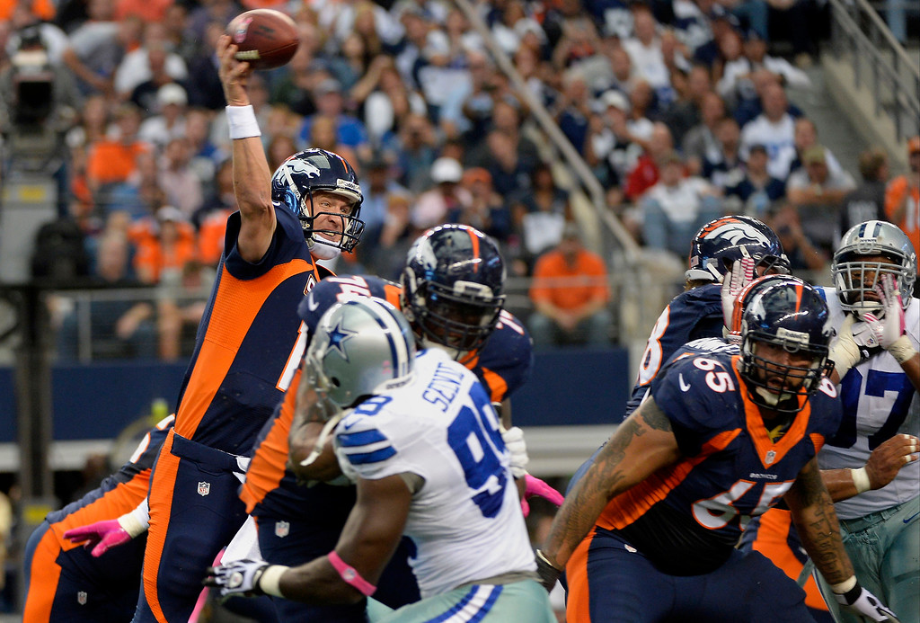 . October 06: Quarterback Peyton Manning #18 of the Denver Broncos hits tight end Julius Thomas #80 of the Denver Broncos to make the score 20-17 in the 2nd quarter vs the Dallas Cowboys in game 5 at AT&T Stadium October 06, 2013 Arlington, Texas. (Photo By Joe Amon/The Denver Post)