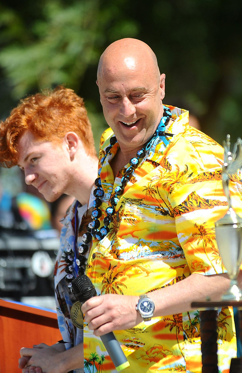 . Principal David P. Fehte dons a Hawaiian shirt during a rally in honor of the Academic Decathlon team\'s seventh national title last week in Honolulu, Hawaii May 1, 2014.(Andy Holzman/Los Angeles Daily News)
