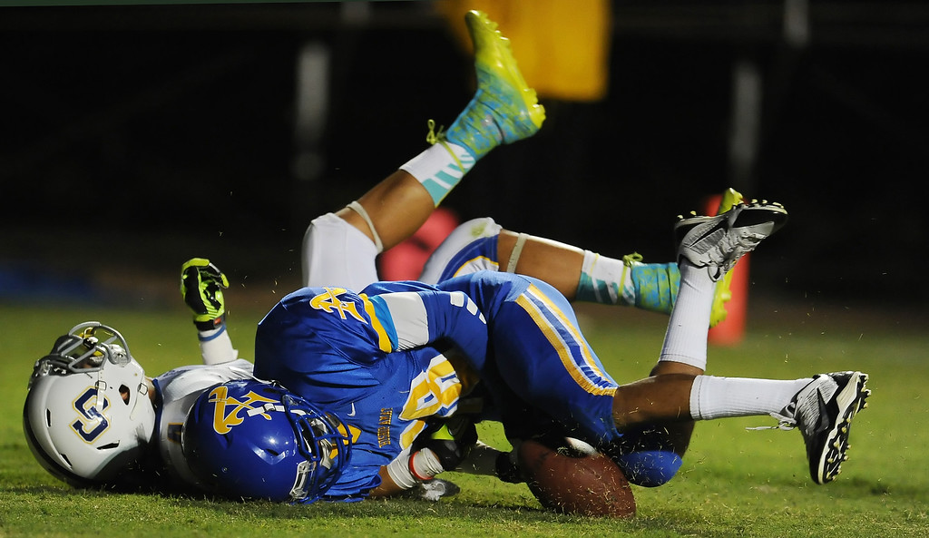 . Bishop Amat\'s Trevon Sidney (18) knocks away a pass intended for Charter Oak\'s Donavin Washington (4) in the first half of a prep football game at Bishop Amat High School in La Puente, Calif. on Friday, Sept. 20, 2013.    (Photo by Keith Birmingham/Pasadena Star-News)