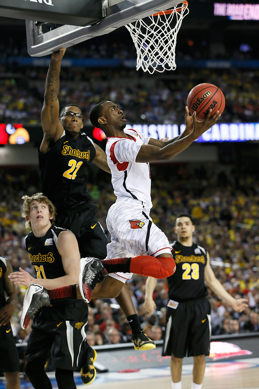 . ATLANTA, GA - APRIL 06:  Russ Smith #2 of the Louisville Cardinals drives for a shot attempt in the second half against the Wichita State Shockers during the 2013 NCAA Men\'s Final Four Semifinal at the Georgia Dome on April 6, 2013 in Atlanta, Georgia.  (Photo by Kevin C. Cox/Getty Images)