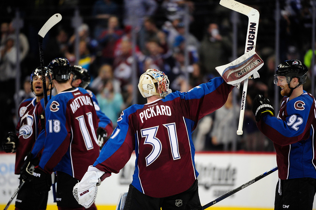 . DENVER, CO - MARCH 3: Colorado Avalanche goalie Calvin Pickard (31) raises his stick to the crowd after the Colorado Avalanche won at the Pepsi Center on March 3, 2016 in Denver, Colorado. The Colorado Avalanche defeated the Florida Panthers 3-2. (Photo by Brent Lewis/The Denver Post)