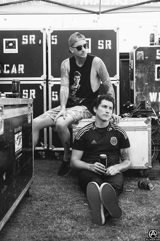 Vic Fuentes and Jaime Preciado of Pierce the Veil at Warped Tour 2015 by Adam Elmakias