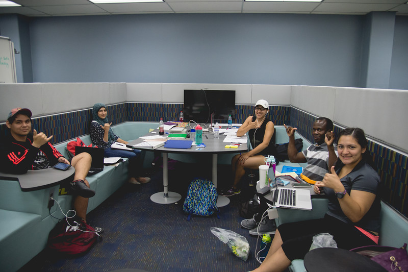 Islanders work collaboratively on their assignments in the Mary and Jeff Bell Library.