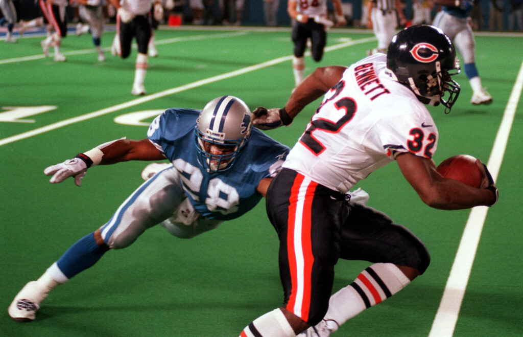 . Ron Rice(28) of the Detroit Lions reaches for Edger Bennett (32) of the Chicago Bears during the opening kick-off in the first quarter during Sunday night\'s game played at the Pontiac Silverdome.