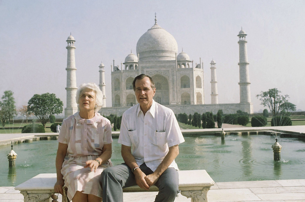 . U.S. Vice President George H. W. Bush, right, and his wife Barbara Bush pose in front of the Taj Mahal, the 17th century monument to love was built by a Mughal Emperor Sahajahan in memory of his beloved queen who bore 14 children, Saturday, May 13, 1984, Agra, India. (AP Photo/Sondeep Shankar)