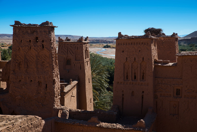 The ksar, a group of earthen buildings surrounded by high walls, is a traditional pre-Saharan habitat. The houses crowd together within the defensive walls, which are reinforced by corner towers. Ait-Ben-Haddou, in Ouarzazate province, is a striking example of the architecture of southern Morocco.  Morocco, 2018.