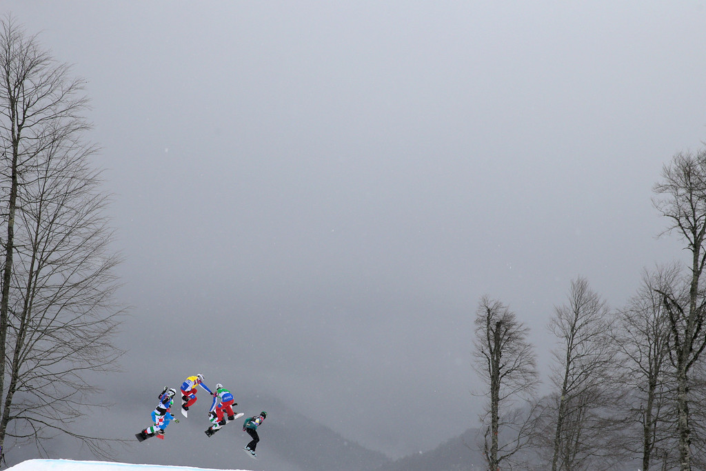 . (L-R) Luca Matteotti of Italy (blue bib), Hanno Douschan of Austria (white bib), Paul-Henri De Le Rue of France (yellow bib), Pierre Vaultier of France (green bib), Omar Visintin of Italy (red bib) and Cameron Bolton of Australia (black bib) compete in the Men\'s Snowboard Cross 1/8 Finals on day eleven of the 2014 Winter Olympics at Rosa Khutor Extreme Park on February 18, 2014 in Sochi, Russia.  (Photo by Adam Pretty/Getty Images)
