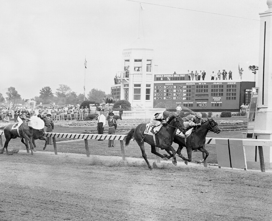 . Jockey Willie Hartack takes his mount, Northern Dancer, under the wire to nose out Hill Rise, ridden by Willie Shoemaker, and wins the 90th running of the Kentucky Derby, at Churchill Downs, Louisville, Kent., May 2, 1964. Northern Dancer went on to win the Preakness Stakes, but finished third to Quadrangle at Belmont. (AP Photo)