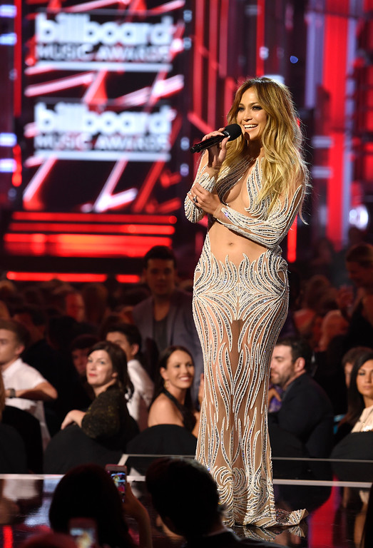 . Jennifer Lopez introduces a performance by Pitbull and Chris Brown at the Billboard Music Awards at the MGM Grand Garden Arena on Sunday, May 17, 2015, in Las Vegas. (Photo by Chris Pizzello/Invision/AP)