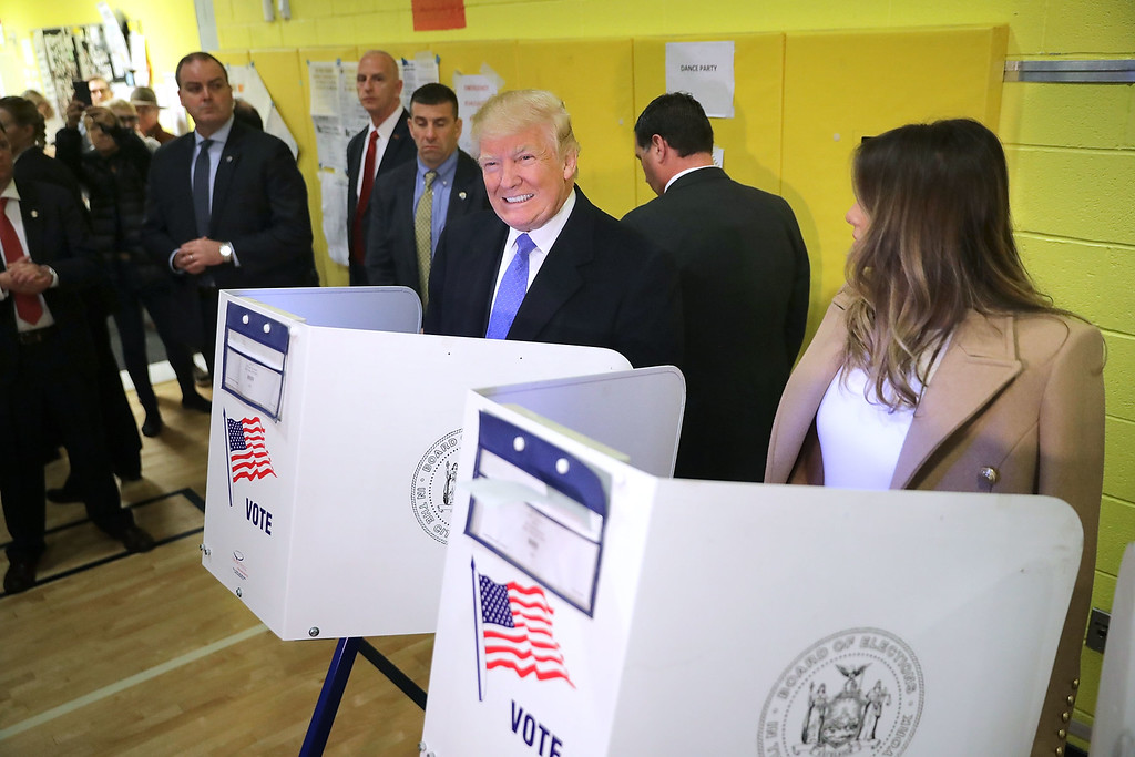 . NEW YORK, NY - NOVEMBER 08:  Republican presidential nominee Donald Trump and his wife Melania Trump cast their votes on Election Day at PS 59 November 8, 2016 in New York City. Trump\'s marathon final two days of campaigning marched through 10 cities in two days, stretching into Election Day.  (Photo by Chip Somodevilla/Getty Images)