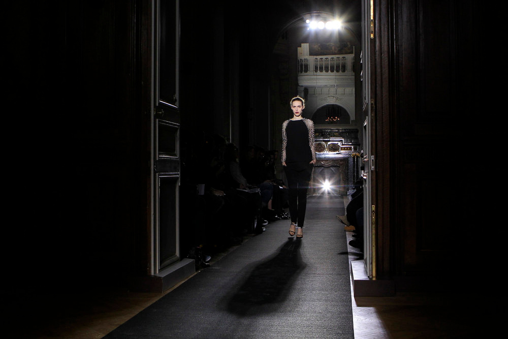 Description of . A model presents a creation by designer Anthony Vaccarello as part of his Fall-Winter 2013/2014 women\'s ready-to-wear fashion show during Paris fashion week February 26, 2013.  REUTERS/Gonzalo Fuentes