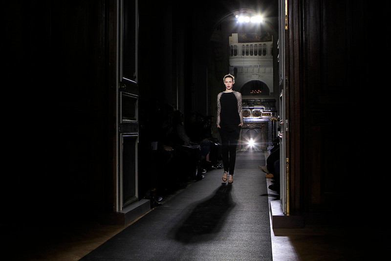 . A model presents a creation by designer Anthony Vaccarello as part of his Fall-Winter 2013/2014 women\'s ready-to-wear fashion show during Paris fashion week February 26, 2013.  REUTERS/Gonzalo Fuentes