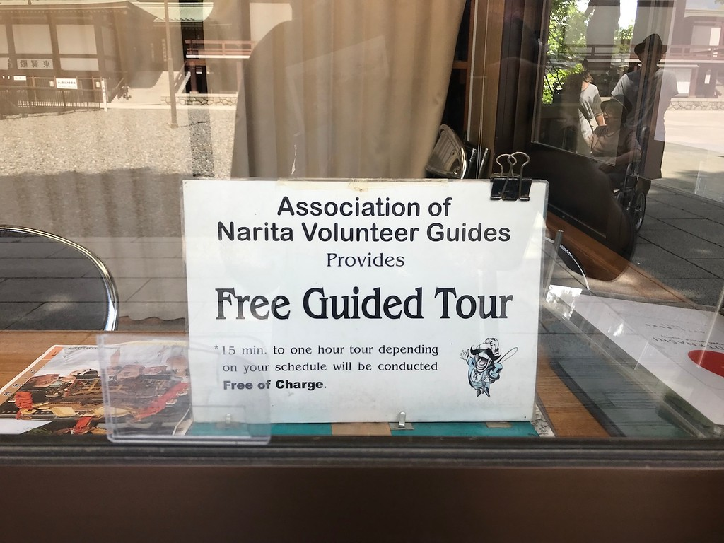 A sign for free walking tours at the temple.