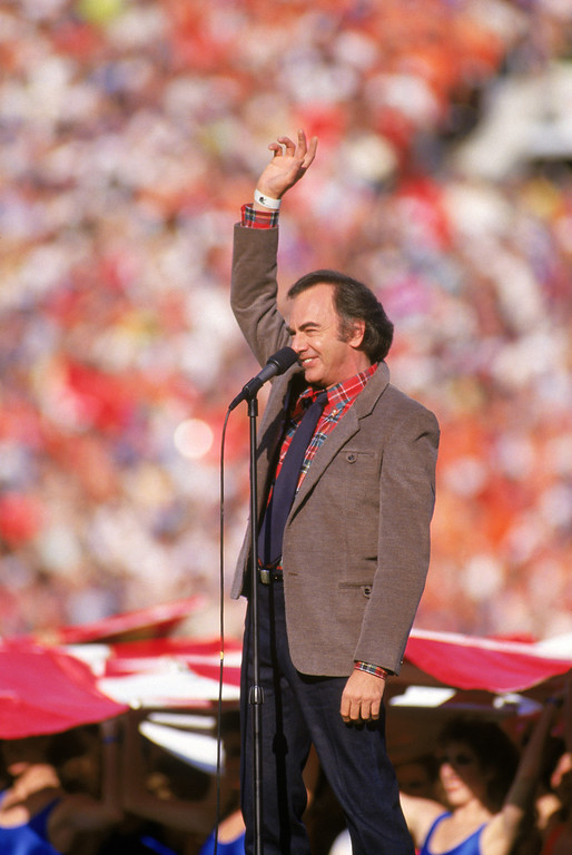 . Neil Diamond sings the National Anthem prior to Super Bowl XXI between the New York Giants and the Denver Broncos at the Rose Bowl on January 25, 1987 in Pasadena, California.   (Photo by George Rose/Getty Images)