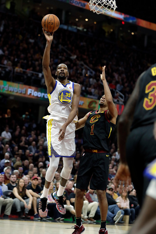 . Golden State Warriors\' Kevin Durant shoots over Cleveland Cavaliers\' Rodney Hood in the first half of Game 4 of basketball\'s NBA Finals, Friday, June 8, 2018, in Cleveland. (AP Photo/Tony Dejak)