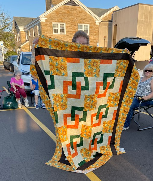 Janet Keesler and her CCQG Mystery Quilt.  Sorry for the wind gust that hid part of the quilt.