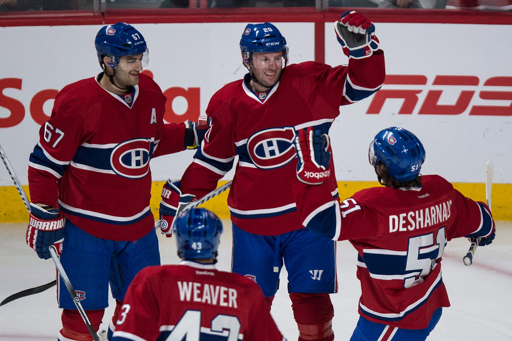 . Montreal Canadiens\' Thomas Vanek celebrates his goal agaisnt the Colorado Avalanche with teammates Max Pacioretty, Mike Weaver and David Desharnais during second period NHL hockey action Tuesday, March 18, 2014 in Montreal. (AP Photo/The Canadian Press, Paul Chiasson)