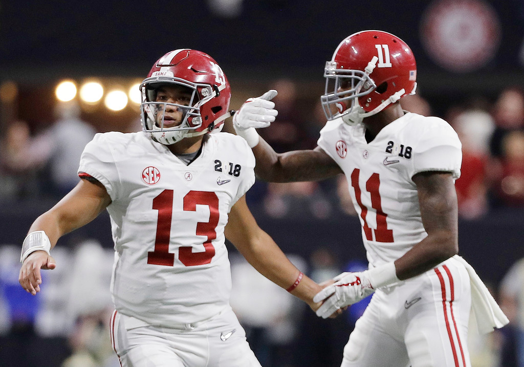 . Alabama quarterback Tua Tagovailoa congratulates Henry Ruggs III (11) after his touchdown catch during the second half of the NCAA college football playoff championship game against Georgia, Monday, Jan. 8, 2018, in Atlanta. (AP Photo/David J. Phillip)