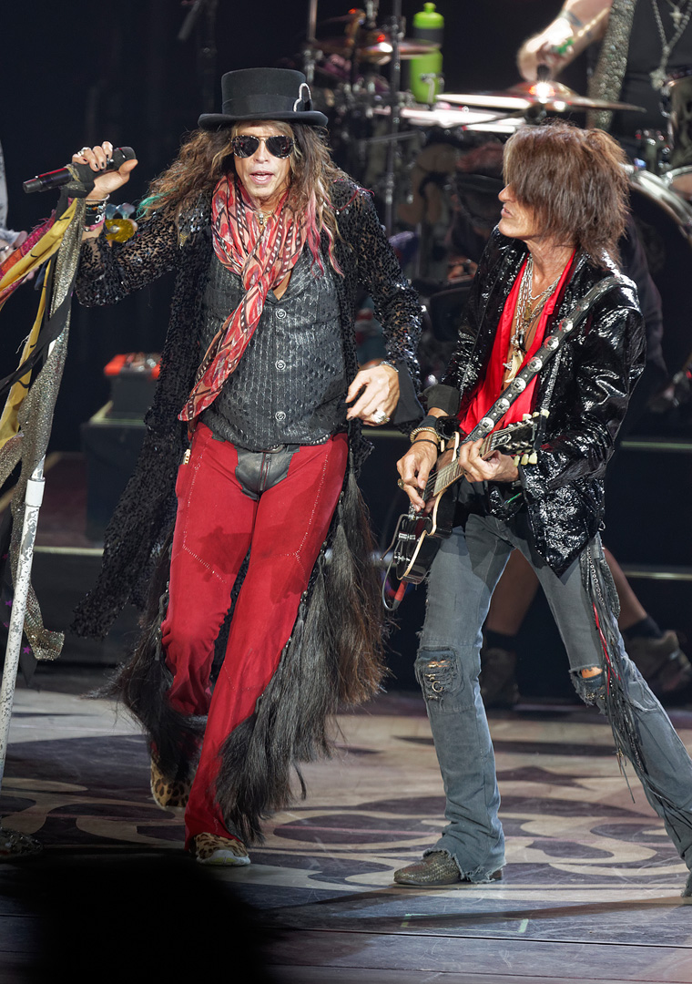 . Steven Tyler and Joe Perry of Aerosmith perform on Tuesday, Sept. 9, 2014, at DTE Energy Music Theatre in Independence Township. Photo by Ken Settle