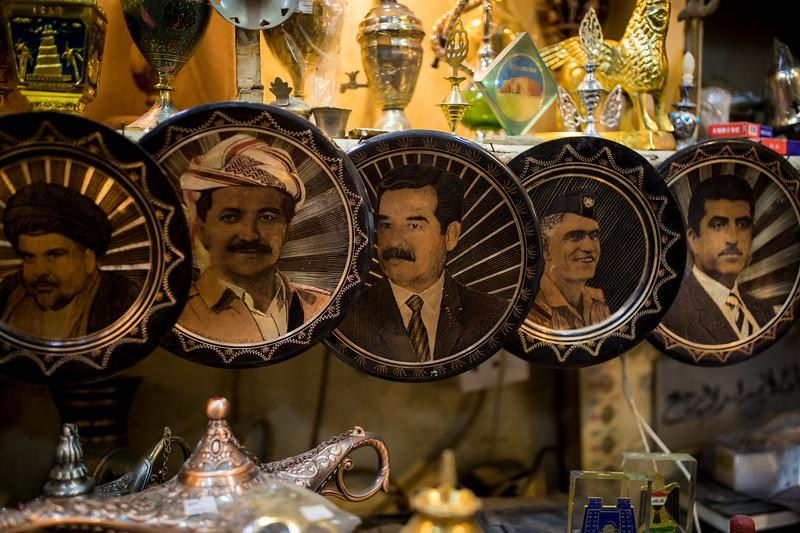 Plates of Iraqi leaders for sale at a shop in the souq. From left is Muqtada al-Sadr (the Iraqi Shia cleric), Masoud Barzani (former President of Iraqi Kurdistan), Saddam Hussein (no introduction needed), Abd al-Karim Qasim (an Iraqi Army brigadier who seized power in the 14 July Revolution in 1958 after the overthrow of the monarchy) and Mustafa Barzani (Kurdish nationalist leader).