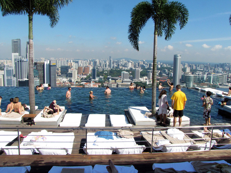 Singapore skyline from SkyPark infinity pool, world's largest. At right, Raffles City tower.