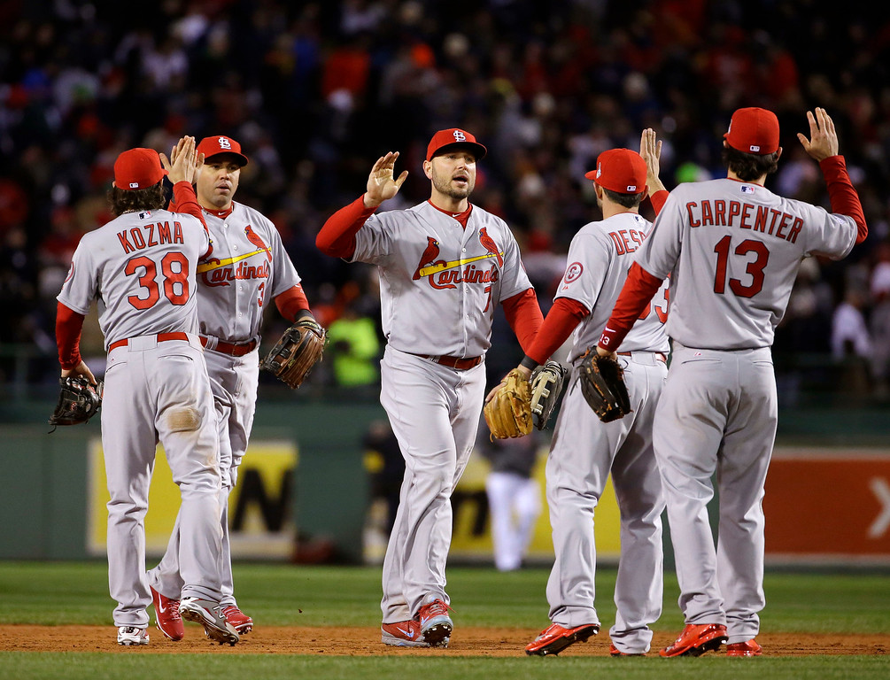 . St. Louis Cardinals players celebrate after defeating the Boston Red Sox, 4-2, in Game 2 of baseball\'s World Series Thursday, Oct. 24, 2013, in Boston. The series is tied at 1-1. (AP Photo/Matt Slocum)