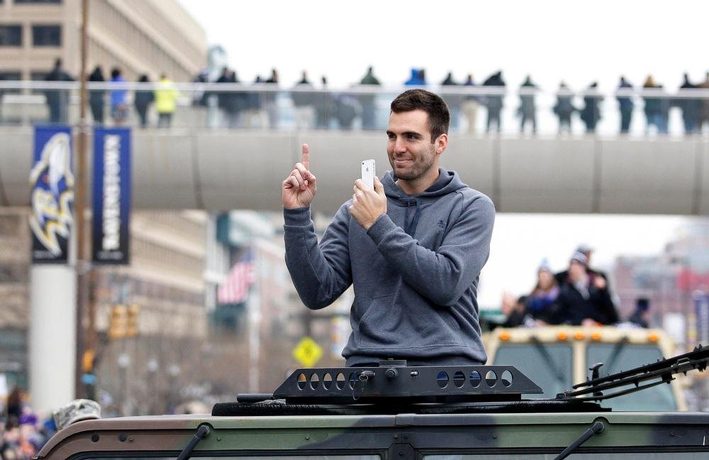 Description of . Baltimore Ravens quarterback and Super Bowl MVP Joe Flacco waves to the crowd gathered on the team\'s parade route in Baltimore, Maryland February 5, 2013. The Ravens defeated the San Francisco 49ers in Super Bowl XLVII in New Orleans.    REUTERS/Richard Clement