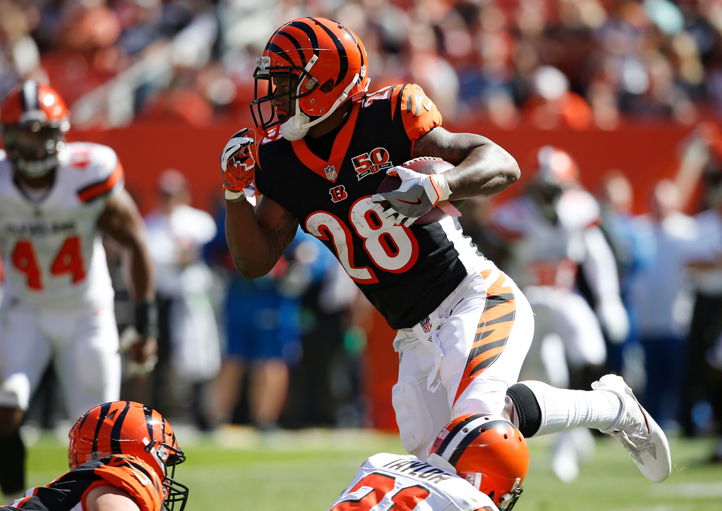 . Cincinnati Bengals running back Joe Mixon (28) runs against the Cleveland Browns in the first half of an NFL football game, Sunday, Oct. 1, 2017, in Cleveland. (AP Photo/Ron Schwane)