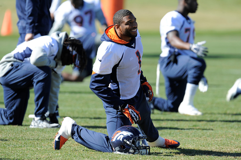 . Denver Broncos Wesley Woodyard (52) stretches before practice on October 30, 2013 at Dove Valley. The players swapped jerseys for Halloween. (Photo by John Leyba/The Denver Post)