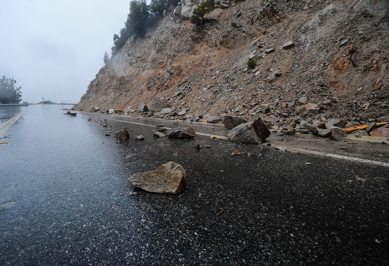 . Fallen rocks and mudslides obstruct Highway 18 in Big Bear Lake, CA on Friday, Feb. 28, 2014. Rock and mudslides from heavy rainfall caused the road closure between Running Springs and Big Bear Lake. (Photo by Rachel Luna / San Bernardino Sun)