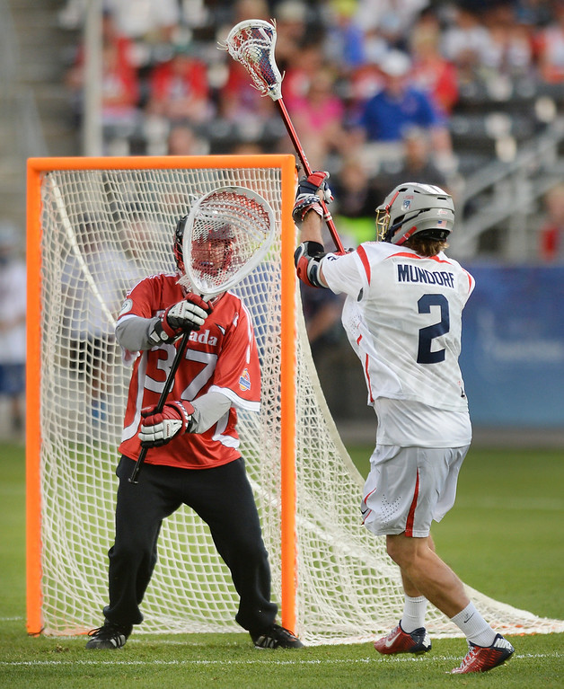 . Canada goalie Dillon Ward made a save on a shot from United States attack Brendan Mundorf (2) in the first half. The United States took on Canada in the opening game of the FIL World Lacrosse Championships Thursday night, July 10, 2014.   Photo by Karl Gehring/The Denver Post