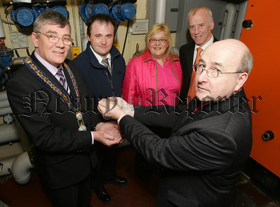 Mayor Michael Carr poictured with Stan McBroom from Lally Design Associates, Gavin McVeigh, Cllr karen McKevitt and Cllr Ciaran Mussen at the opening of the new wood pellet heating system at the Council Offices Monaghan Row. 07W8N17