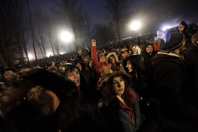 . The crowd cheers during festivities of Groundhog Day where Punxsutawney Phil saw his shadow predicting six more weeks of winter during 128th annual Groundhog Day festivities on February 2, 2014 in Punxsutawney, Pennsylvania. (Photo by Jeff Swensen/Getty Images)