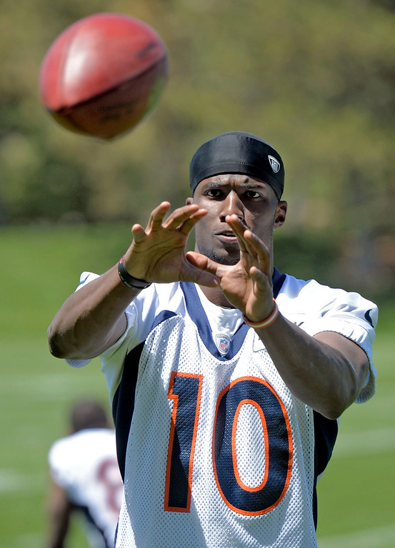 . Denver Broncos Gerell Robinson (10) catches passes after practice during OTA\'s May 30, 2013 at Dove Valley. (Photo By John Leyba/The Denver Post)