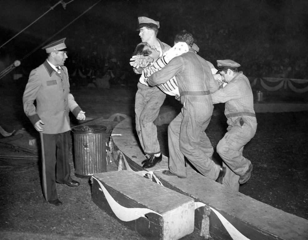 ". Prop men at the Ringling Brothers and Barnum and Bailey Circus remove a trapeze performer, identified as Friedrich Hermsen, from a center ring after Hermsen plunged 40 feet when the bar on which he was doing a headstand broke. The accident occurred at Madison Square Garden, New York, May 6, 1949. Hermsen, known professionally as ""The Great Trisko\"", was taken to nearby Polyclinic Hospital. His wife, who assisted in the act, saw Hermsen fall and accompanied him to the hospital. (AP Photo)"