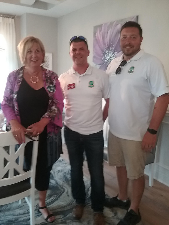 . Pictured in the dining room of the Dream House are (left to right) Karen Krauss, Dream House co-design coordinator and Josh Edgell and Chuck McClintock of JEMM Construction, the company that built the home.(Jean Bonchak)