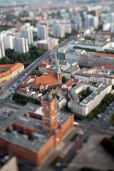 Aerial view from the TV Tower of the City Hall and Nikolaikirche (focus on the Nikolaikirche), Berlin, Germany. Tilted lens used for a shallower depth of field and to create, combined with the aerial view, a miniaturization effect.