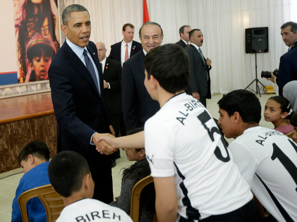. President Barack Obama greets members of a local youth soccer team during his visit to the Al-Bireh Youth Center in the West Bank city of Ramallah, Thursday, March 21, 2013. (AP Photo/Pablo Martinez Monsivais)