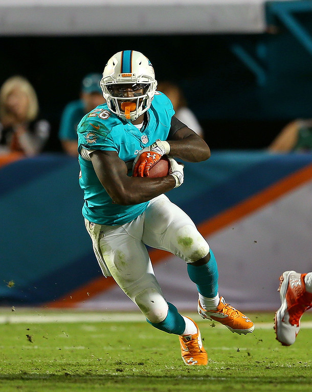 . MIAMI GARDENS, FL - OCTOBER 31: Lamar Miller #26 of the Miami Dolphins rushes during a game against the Cincinnati Bengals at Sun Life Stadium on October 31, 2013 in Miami Gardens, Florida.  (Photo by Mike Ehrmann/Getty Images)