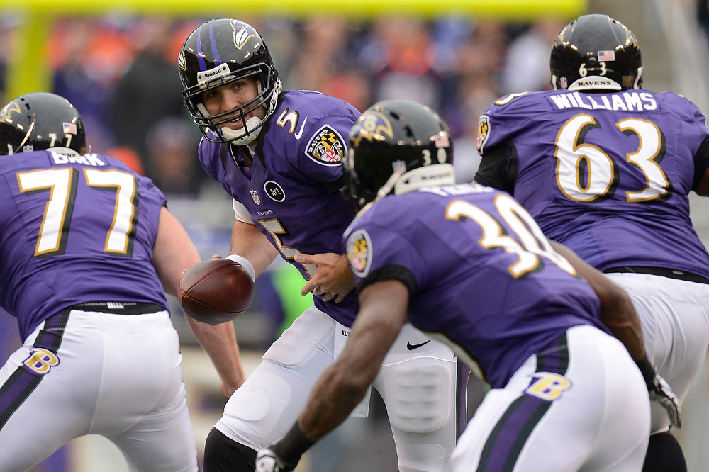 Description of . Baltimore Ravens quarterback Joe Flacco #5 hands off to running back Bernard Pierce #30 at the M&T Bank Stadium, in Baltimore, MD Sunday December 16, 2012.      Joe Amon, The Denver Post