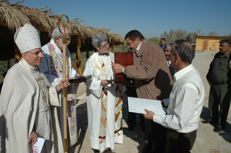 A representative of the Jordan Baptism Site Commission presents a gift to ELCIC National Bishop Susan Johnson.  With Johnson, from left, are ELCJHL Bishop Munib Younan and ELCA Presiding Bishop Mark Hanson.