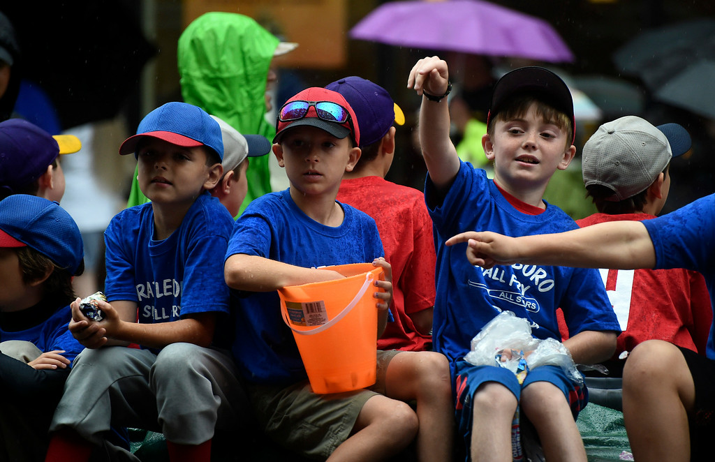 . Kayla Rice/Reformer Brattleboro Small Fry players throw candy in the Brattleboro Fourth of July parade on Friday.