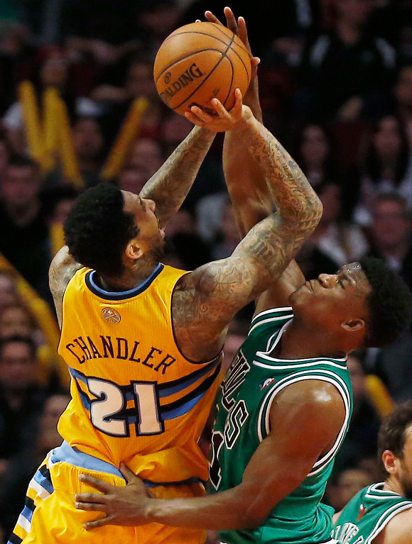 . Denver Nuggets\' Wilson Chandler (L) goes to the basket against Chicago Bulls\' Jimmy Butler during the second half of their NBA basketball game in Chicago, Illinois March 18, 2013. REUTERS/Jim Young