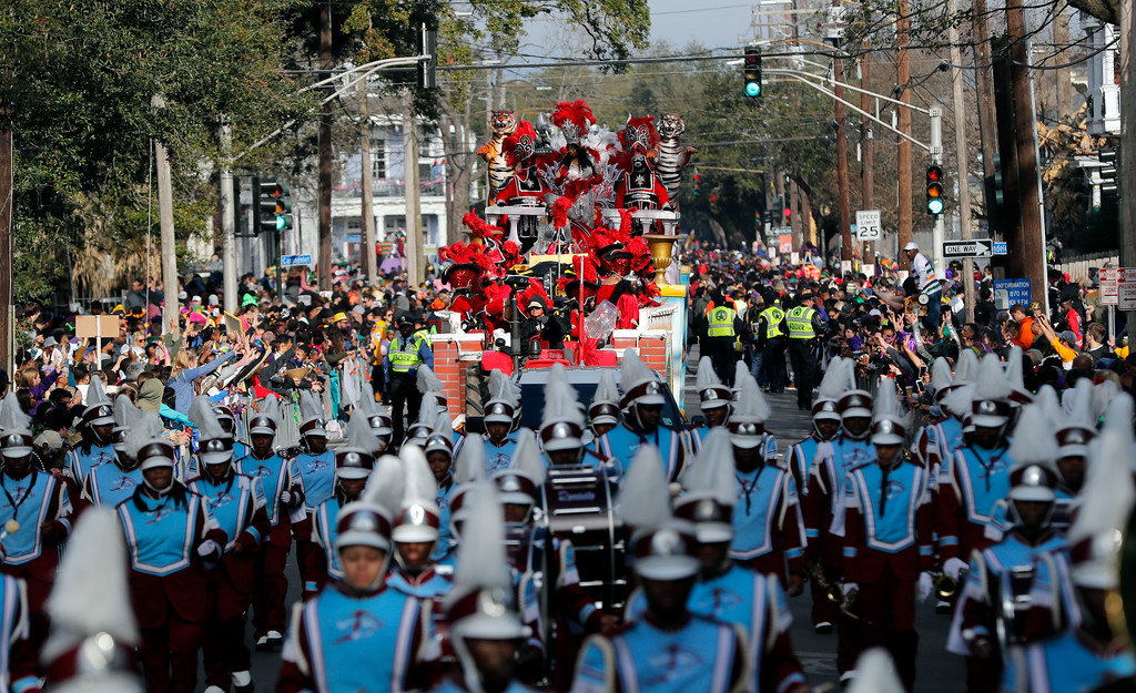 . The Krewe of Zulu marches as they roll on during Mardi Gras day in New Orleans, Tuesday, Feb. 13, 2018. (AP Photo/Gerald Herbert)
