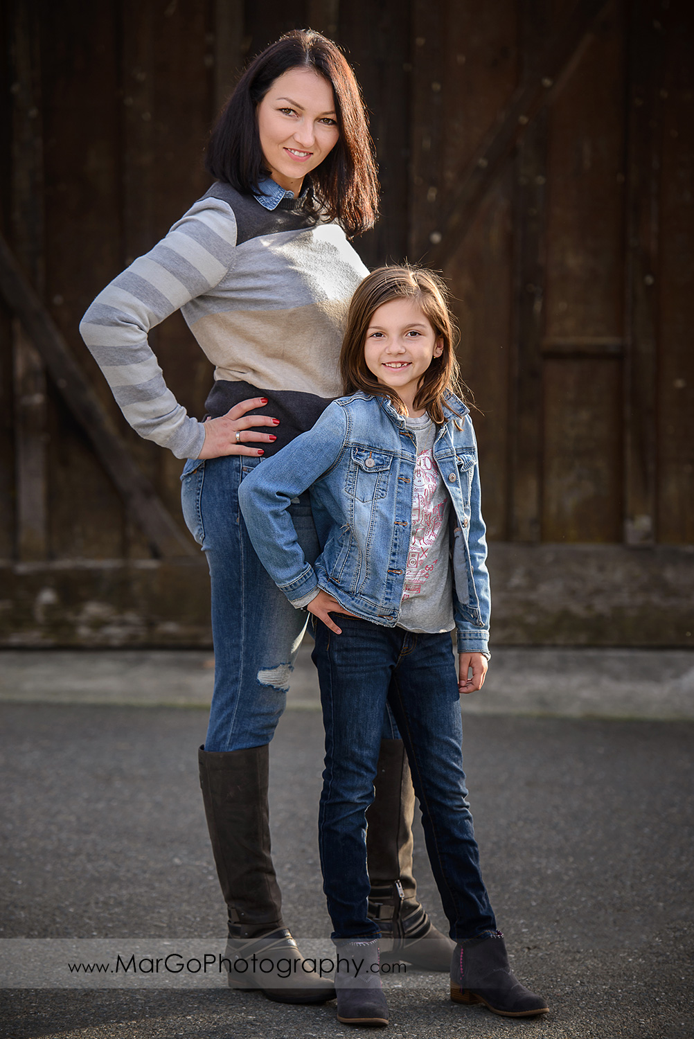 full body vertical portrait of mother and dauther in blue and grey clothes mother posing like models during family session at Old Borges Ranch in Walnut Creek